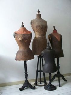 Antique mannequins or dress forms.
