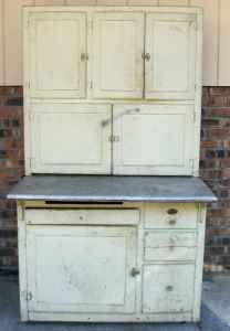 I would love to rehab this...replace the knobs, add some paint, do something with the counter, add glass to some doors perhaps, etc... It would be very useful as a arts&crafts unit or dresser or in the actual kitchen or by the front door or...