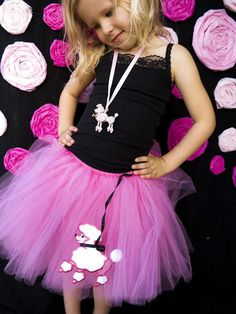 pink poodle puppy birthday party with black and white accents birthday girl Ashlee in tutu outfit with poodle accents