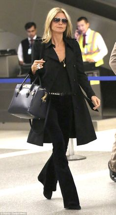 Natural look: Heidi Klum appeared to not be wearing much make-up for her long-haul flight...