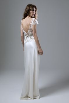 Wedding dress by Halfpenny London | Bridal Fashion by Kate Halfpenny | soft lace, high neck top, with low V back, faux covered button detail, french lace, bias satin, low back slip, spagetti straps ,no train, crepe back satin. Iris Jacket & Iris Slip.