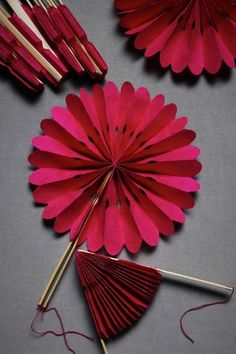 accordion flowers made into fans. I should have thought of this