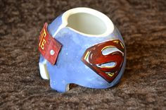 Superman Cranial Band/helmet   https://www.facebook.com/pages/Cranial-BandsMurals-by-Leigh-Gibson/153150921414230?ref=hl