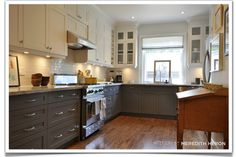 Meredith Heron kitchen - charcoal grey cabinet color. I love that the cabinets are 2 different colors