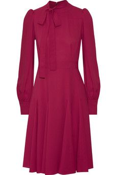 Gucci's silk-crepe dress has a chic plum hue that complements any skin tone. This flattering and feminine style is finished with a pussy-bow collar, padded shoulders and a defined waist. Godet pleats through the skirt ensure elegant movement as you walk.