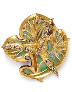 Art Nouveau 18kt Gold and Plique-a-Jour Enamel Brooch, France, designed as an exotic bird and foliage with rose-cut diamond accents, lg. 1 5/8 in., maker's mark and guarantee stamps.