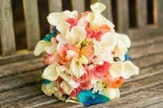 Beautiful bridal bouquet in shades of salmon ,and peaches.  Miniature Calla Lillies,  white dendrobian orchids,   blue phalenopsis orchids and shades of peach and coral roses  photography @menningphoto  #jennywehrwillow #willowsbywehr #weddingflowers #youngstownweddings #columbianaflorist  330.482.2223
