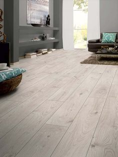 Everest Oak White laminate @ $1.71/sqft. Brighten up your home with the Kronotex Mammut Collection.