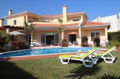 Villa des Dunes, Praia d'El Rey, Peniche, Portugal. Contemporary holiday rental villa with lovely pool area and views across the golf course, perfect for families with younger children.
