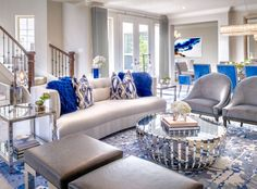 Amazing Blue and White Living Room Decor Luxury London living room decor in white blue and grey with curved modern sofa and grey velvet chairs. Blue And White Living Room, Blue Living Room Decor, Coastal Living Rooms, Home Living Room, Interior Design Living Room, Living Room Designs, Blue Living Room Furniture, Interior Decorating, London Living Room