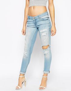 $76 Image 1 ofRiver Island Cara Low Rise Ripped Jeans
