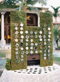 Mirror place cards on a moss backdrop: