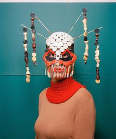 Stunning Masks Built from Board Game Pieces