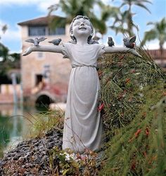 Basking in God's Glory Little Girl Statue (Medium).  Delight in the joy of pure praise with this darling little girl statue raising her arms full of feathered friends! This magnificent girl sculpture is cast in quality designer resin and hand-painted. Our little girl figurine is as at home indoors as our, alerting fellow gardeners that you take the beauty of the exterior of your home as seriously as the interior. #gardenstatue #statue #gardendecor