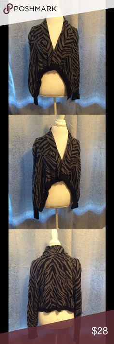 Express Animal print cardigan - NWT Express zebra print asymmetrical cardigan with a drape front. 100 percent cotton. Stylish and cozy. Perfect touch to any outfit. Used ones are being priced 30 plus on other sites. Express Sweaters Cardigans