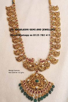 If you want the best Bridal Haarams just visit Sri Mahalaxmi Gems and Jewellers. Presenting here is a long length Bridal mango haaram Studded with rubies n Emeralds. visit for full variety at wholesale prices. Phone no 8125 782 411 20 November 2018 Mango Mala Jewellery, Indian Jewelry Earrings, Wedding Jewelry, Temple Jewellery, India Jewelry, Gold Earrings, Gold Jewellery Design, Gold Jewelry, Gold Necklaces