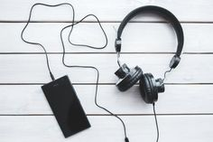 Black Headphones With Mobile Smartphone Picture. Black headphones with mobile smartphone. Playlists, Bluetooth Headphones, Over Ear Headphones, Best Music Downloader, Smartphone Reconditionné, Free Music Download App, Musica Spotify, Reputation Management, Free Black