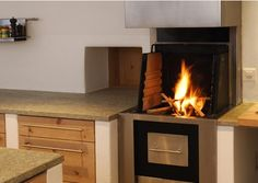 Cook Cook, a wood-burning oven, grill, heating system, and kitchen fireplace all in one.