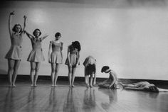 "Posture Class for Girls at Barnard College, students demonstrating the ""drooping daisy"" exercise for relaxation. Walter Sanders, 1954."