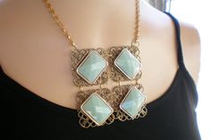Mint green and gold bib styled necklace by OutsiderArtJewelry