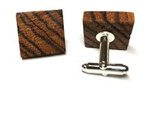 These stunning wooded cufflinks are made from Dark Walnut wood. A beautiful accessory for any gent.