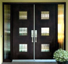Contemporary Double Door with Glass & Sidelites This custom door revels in mid-century retro style. The geometric glass design and black finish combine create a stunning contemporary effect. Front Doors With Windows, Double Front Doors, Front Door Entrance, House Front Door, Glass Front Door, Front Door Decor, Entry Doors, Front Entry, Glass Doors