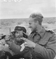 A cine-cameraman of the Army film and photo Unit accompanies the patrols to photograph their activities. He is seen here showing a bit of film to the patrol commander. The patrol commander is possibly of the Long Range Desert Group or even early SAS North African Campaign, Special Air Service, British Armed Forces, War Image, British Army, Special Forces, Vietnam War, Military History, World War Two