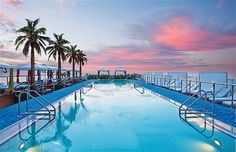 The world's best hotel pools -   Gansevoort South, Miami  This elevated, 110ft-long pool, overlooks Miami Beach and is fringed by colourful cabanas and sun loungers. The 26,000 sq ft adults-only roof terrace is also home to Plunge, a bar with oversize white-cushioned couches, chairs, umbrellas and towering 20ft palm trees.