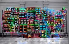 Nam June Paik,Electronic Superhighway: Continental U.S., Alaska, Hawaii, 1995, fifty-one channel video installation (including one closed-circuit television feed), custom electronics, neon lighting, steel and wood; color, sound, approx. 15 x 40 x 4 feet (Smithsonian American Art Museum) © Nam June Paik Estate