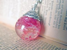 Rose Petals and Glitter Resin Pendant Necklace - real rose petals encased in resin orb, Pressed Flower Jewelry.  Etsy.