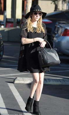 Emma Roberts looked every inch the vampy vixen as she rocked a gothic glamour-inspired ensemble while out and about in Los Angeles