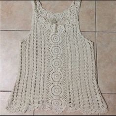 Boho crochet tank Super funky boho crochet tank in cream.  Great for layering or even as a swimsuit cover up.  I'm a size xs- so I later it over a black slip as a dress. Tank is size L from forever 21. Forever 21 Tops Tank Tops