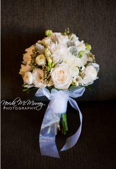 BG215 Vendella roses, white lisianthus, ranunculus, white freesias, berzillea berry and silver dust foliage