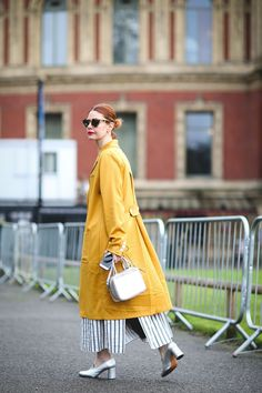 30 Brilliant Street Style Moments From 2016 #refinery29  http://www.refinery29.com/2016/12/133987/best-street-style-2016#slide-13  Refinery29's global editor-in-chief, Christene Barberich, perfectly color-coordinates with the golden surroundings of Kensington Gardens in this Houghton and Rachel Comey look, accessorized with a Michino Paris bag....