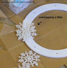dollar store christmas crafts now-to-make-a-snowflake-wreath Easy Christmas Decorations, Diy Christmas Ornaments, Holiday Wreaths, Holiday Crafts, Snowflake Decorations, Christmas Swags, Burlap Christmas, Handmade Decorations, Snowflake Wreath