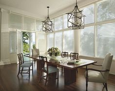 The elegant design of Hunter Douglas Silhouette® window shadings adds luminous beauty to this dining room. ♦ Hunter Douglas window treatments #Decor #Design #Iconic