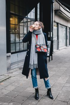 justthedesign: Paulien Riemisis cute and casual in this stylish winter look consisting of rolled denim jeans a double breasted navy overcoat and a pair of striking patent leather boots. Tee: H&M Cardigan/Boots: Zara Coat: River Island Bag: Pinko. Mode Outfits, Casual Outfits, Fashion Outfits, Fashion Weeks, Fashion Tips, Fall Winter Outfits, Autumn Winter Fashion, Winter Layering Outfits, Spring Outfits
