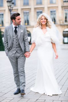 Can you imagine walking the streets of Paris on your wedding day? This gallery is filled to overflowing with perfect Bride & Groom portraits! See more here: http://www.StyleMePretty.com/destination-weddings/2014/05/20/intimate-winter-wedding-in-paris/ Photography: OneAndOnlyParisPhotography.com