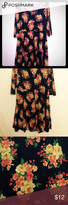 Floral A-line dress Navy floral a-line dress with 3/4 sleeves. Perfect condition only worn once. Pinc Dresses