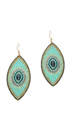 Miguel Ases earrings in a slim iris shape glitter with sea-blue beads. French hook
