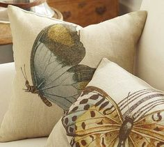 Gorgeous Pottery Barn pillows.  Click for tutorial on making your own.  She used a butterfly stencil she made herself and painted in with black.  I would add more colors to tie in with my living room colors.  LOVE!