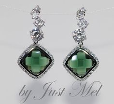 Cascading Round Cubic Zirconia Earring with Emerald Green Fancy Glass (E467). $39.99, via Etsy.