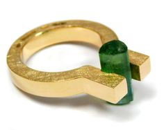 Gold ring with turmaline.