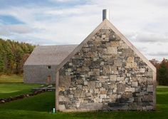 Rick Joy created this gable-roofed, steel-framed cedar-shingle-and-stone house and barn in Vermont.