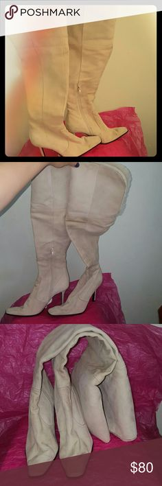 """Nine West 6.5 M over the knee suede boots 3.5"""" covered heel. Shaft is 20,"""" foldable part starts at 13.5."""" Faux fur cuff. Partial inside zipper closure. Pink fabric lining. Pink leather trim (inside, zipper part) is starting to partially flake off. This pair is new!  Suede upper has dirt marks, possibly can be cleaned, some glue marks that won't be seen when cuff is folded. Great pair but with some cosmetic imperfections. If you need more pics please ask but don't ask me to model these since…"""