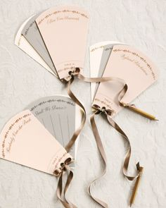 Escort cards were designed as old-fashioned dance cards; pencils, attached with ribbons, encouraged guests to schedule spins.