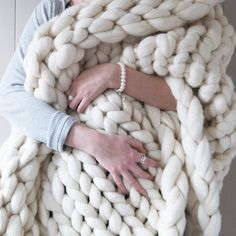 This amazing chunky knit blanket will keep you warm and cosy all year round. Made entirely by hand from beautifully soft Merino wool!