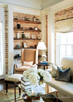 Great way to incorporate shelves against a brick wall. Beautiful, too!