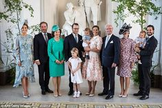 Family portrait (l-r) Princess Madeleine, her husband Christopher O'Neill, Queen Silvia, Prince Daniel, Princess Estelle (in front), Crown Princess Victoria (with Prince Oscar in arms), King Carl Gustaf, Princess Sofia, Prince Carl Philip (with Prince Alexander in arms)