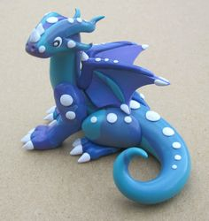 This is a teal dragon with royal purple (the purple is more prominent than in the photo) swirled into his body with little white accentuating spots! Royal Purple and Teal Polymer Clay 'Scrap' Dragon Polymer Clay Dragon, Polymer Clay Dolls, Dinosaur Origami, Cute Clay, Clay Food, Teal, Purple, Sculpture Clay, Little White